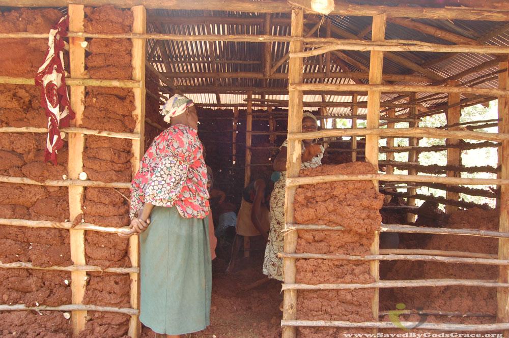 grandma-inspecting-mud-walls