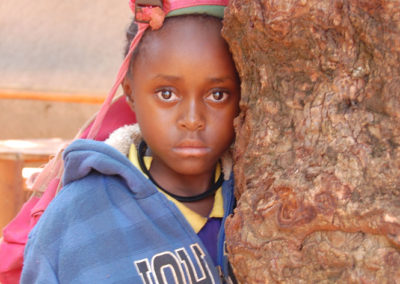 little-girl-by-tree